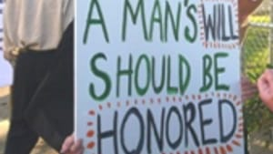 Protesters at the ceremony: Be careful what you wish for.