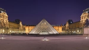 The Louvre pyramid at night (photo by Benh LIEU SONG, via Wikimedia Commons)