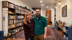 Partners in life and in the book business: Christina Rosso-Schneider and Alex Schneider open their Passyunk store. (Photo by Catherine Smith.)
