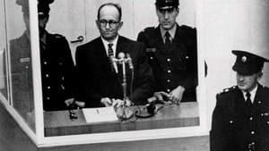 Eichmann appeared behind a glass enclosure during his 1961 trial; film of the proceedings appears at the end of 'Operation Finale.'  (Photo from the Huntington, via Creative Commons/Flickr.)