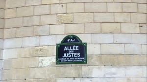 """Language can divide or repair: a Marais street sign becomes """"The Avenue of the Just,"""" for Jewish allies in World War II. (Photo by Anndee Hochman.)"""