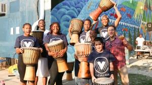 Drummer Andrés Cisneros and students. Photo by Melissa B. Skolnick.