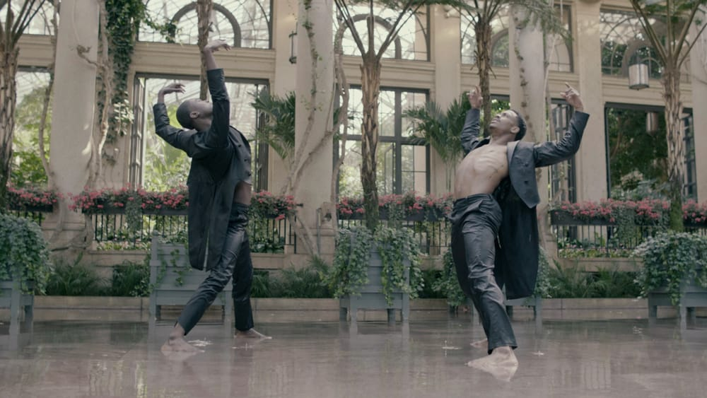 An awakening among the greens: Stanley Glover and Roderick Phifer in Robbie Fairchild's 'The Cycle.' (Image courtesy of BalletX.)