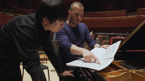 Yannick Nézet-Séguin reviews rehearsal notes with pianist Lang Lang at a 2016 appearance at the Kimmel Center. (Photo courtesy of History Making Productions.)