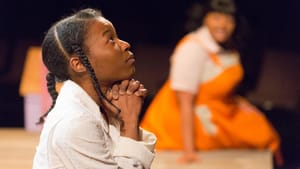 Jasmine Ward's Pecola prays for blue eyes in the Arden's production. (Photo by Mark Garvin.)