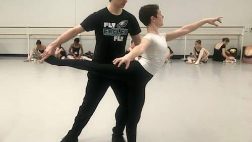 Pennsylvania Ballet principal dancer Sterling Baca, shown here with a School of Pennsylvania Ballet Summer Intensive student, loves the discipline's rigor. (Photo courtesy of the School of Pennsylvania Ballet.)