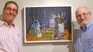 Ed Bronstein shows off one of his favorites at Rosenfeld. Photo by Susan Perloff.