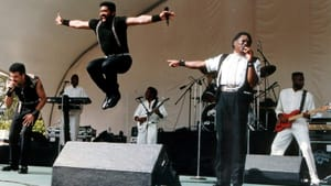 When the lyrics fly as well as the music: The Commodores onstage. (Photo by Carl Lender, via Wikimedia Commons.)