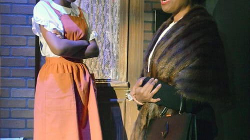 Smith's Aunt Lily imparts wisdom to Greer's young Ermina. (Photo courtesy of South Camden Theatre Company.)