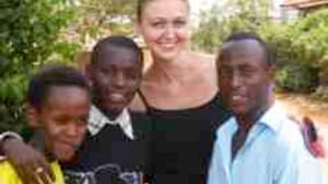 Davis with 'her' kids in Kigali (Christian at right): What makes them smile?