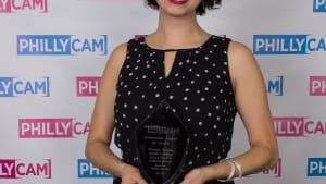 Elizabeth Estrada with an Innovation Award for her work with Atrévete. (Photo by R. Brooks.)