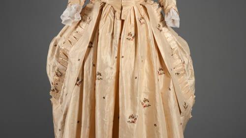 This brocaded English silk taffeta dress, worn à la polonaise, dates to 1780. (Photo by Michael Shepherd for FHCC.)