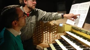 Boldly harnessing the organ at Notre Dame Cathedral: composer Gerald Levinson with organist Olivier Latry rehearsing for the 2013 premiere of 'Au Coeur de l'Infini.' (Photo by Nanine Valen.)