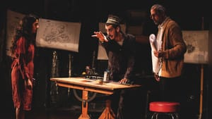 A metaphor for art-making under oppression: the characters of 'Grey Rock' build a rocket. (Photo by Carlos Cardona.)