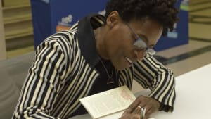 'Another Brooklyn' author Jacqueline Woodson signs at the Free Library. (Image via the Free Library.)