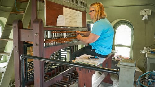 The ultimate socially distanced instrument: Janet Tebbel plays carillon at Miraculous Medal Shrine. (Photo by Sharon Torello.)