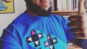 Wearing gear from Xavier Woods's 'UpUpDownDown,' Kyle shows love for fellow Black nerds. (Photo by Kyle V. Hiller.)