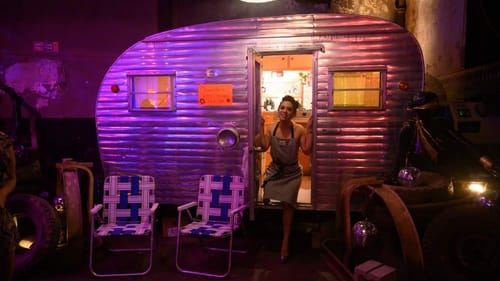 Where the flame gets sublimely close: Messapotamia Lefae and her camper. (Photo by Johanna Austin, austinart.org.)