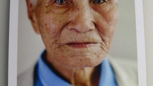Nam Keung-bong, 87, lost his only chance to see his wife and son after a lifetime apart. (Photo by Pamela J. Forsythe; original artwork by Laura Elizabeth Pohl.)