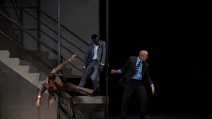 The bodies of three male actors in Love Unpunished lean and veer in different directions at the bottom of a staircase.