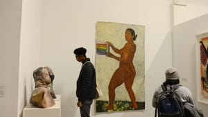 A visitor views Elia Alba's 'Busts' and Maquitta Ahuja's 'Hocus Pocus.' (Photo courtesy of Asian Arts Initiative)