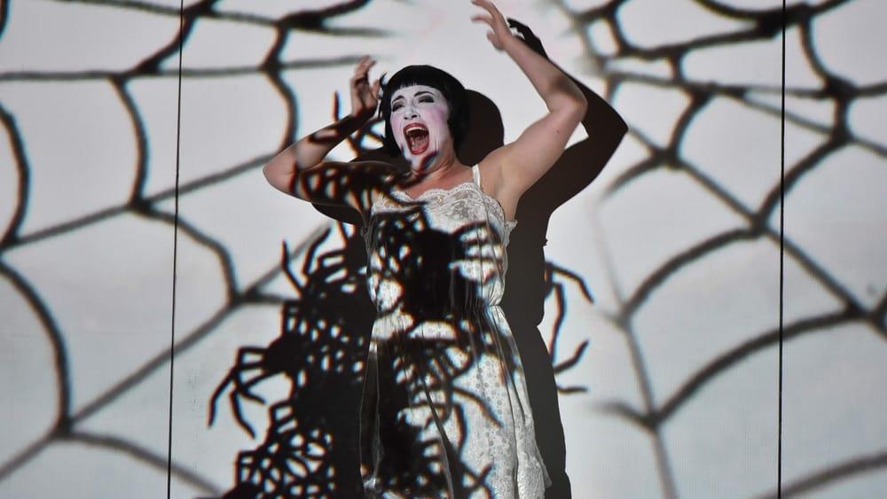 Pamina (soprano Rachel Sterrenberg) has been ordered to kill Sarastro. (Photo by Kelly & Massa Photography.)