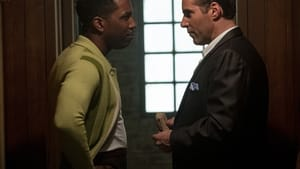 Leslie Odom Jr. and Alessandro Nivola face each other in profile in a scene from the movie.