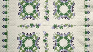 'Grapes and Vines,' by Mary Schafer, c. 1972. Cotton with Polyester Batting, 88 x 98. Mary Schafer's 'Grapes and Vines' is patterned after a quilt pictured in Marie Webster's classic 1915 book, Quilts. The intricate appliqué design was a trademark of Webster's work. Schafer received the pattern from the estate of Betty Harriman in 1971. (Photo by KEVA, all rights reserved, Michigan State University Museum.)