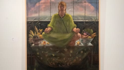 Why is she meditating with vegetables? Just go with it in Jeff Dion's 'Earth.' (Photo by Dave Rizzio.)
