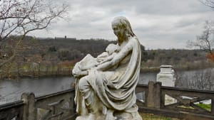 Mother and Twins Monument by Henry Dmochowski Saunders, commemorating his wife and children. The site overlooks the bend in the Schuylkill River where the twins drowned. (Photo by Smallbones via Creative Commons/Wikipedia)