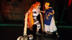 Jered McLenigan (left) and Mary Tuomanen re-enact the ancient tale of the yellow boy and his orange-haired stalker. (Photo by Johanna Austin, austinart.org.)
