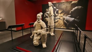 Two statues stand guard at the Franklin Institute's 'Terracotta Warriors of the First Emperor' exhibition. (Photo courtesy of the Franklin Institute.)