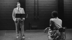 The play's emotional center: Billie Krishawn as Suzanne Alexander, with Rex Daugherty as Robert Hampshire in 'Ohio State Murders.' (Image courtesy of Round House Theatre.)