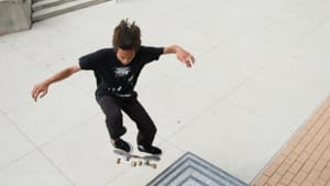 A skater tries out Monk's work. Photo by Steve Weinik for the City of Philadelphia Mural Arts Program.
