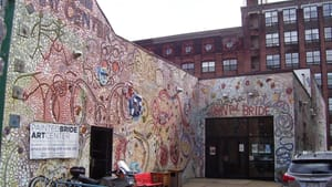 The Painted Bride's iconic Isaiah Zagar mosaic facade wraps around the building's exterior. (Photo via Creative Commons/Wikipedia.)