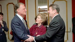 Pastor to the powerful: Graham with the Reagans. (Photo via Creative Commons/Wikipedia.)