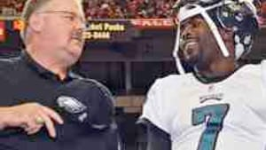 Coach Reid (left) with gunslinger Vick: The family that prays together...