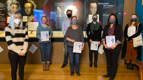 Choral singing is about community: composer Melissa Dunphy (left) visits the famous letter with members of PhilHarmonia. (Photo courtesy of the Museum of the American Revolution.)