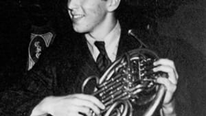 Schuller with his French horn, c. 1940s.