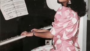 Kapoor at home on her old upright Yamaha. (Photo courtesy of Shaila Kapoor)