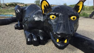 A 36-foot-long black panther made from repurposed car hoods by Don Kennell and Lisa Adler. (Image courtesy of A New View.)