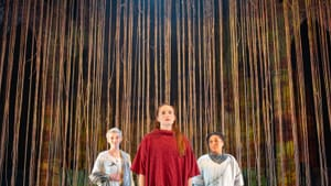 Joan of Arc (Clare O'Malley, center) in the company of her embodied voices, Mary Tuomanen and Tai Verley. (Photo by Matt Urban at Mobius New Media.)