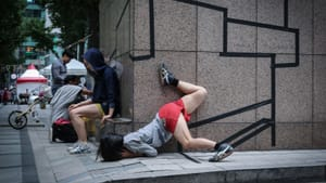 A 'Tape Riot' performer in Seoul, South Korea, interacts with the urban environment. (Photo by Anna Anderegg.)