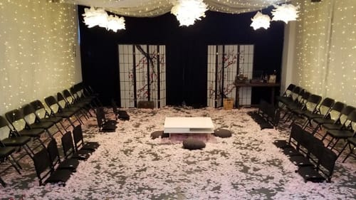 Awash in cherry blossoms: the stage of EgoPo's 'And Tell Sad Stories.' (Image courtesy of EgoPo.)