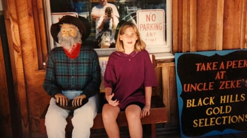 I don't think it was my idea to sit next to Uncle Zeke. But I look great. (Photo by Alaina's parents.)