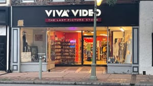 The Viva Video storefront, with large figures of Jack Skellington and The Wizard of Oz cast. Shelves of DVDs are inside