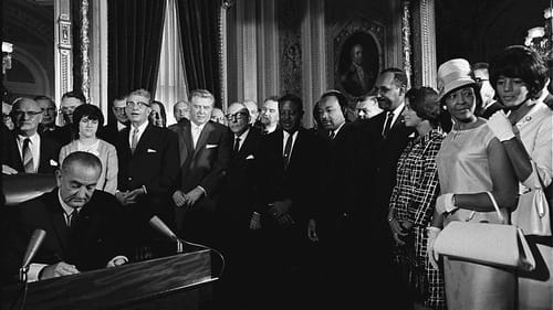 President Lyndon B. Johnson signs the Voting Rights Act of 1965. Obviously, racism did not end here. (Image via Wikimedia Commons.)