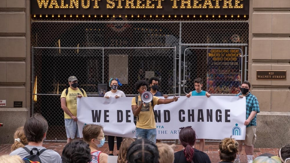 Protest co-organizer Garrick Morgan speaks to the crowd outside the Walnut on June 18. (Photo by Matthew Wright.)
