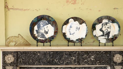 Art that speaks to the building: Three of Roberto Lugo's portrait plates. (Photo by Ryan Collerd.)