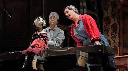 Not the most dynamic scene partner: Elza van den Heever's (right) son is a puppet. (Photo by Ken Howard for the Met Opera.)